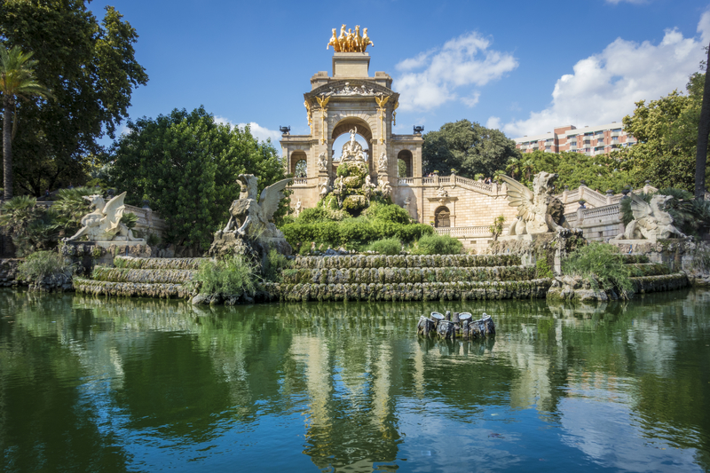 Barcelona park with pond and monument